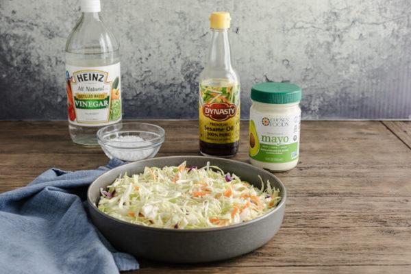 Keto coleslaw ingredients: angel hair slaw, white vinegar, low carb sweetener, toasted sesame oil & mayonnaise