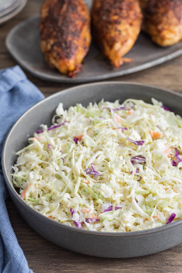 A bowl of keto coleslaw with BBQ chicken