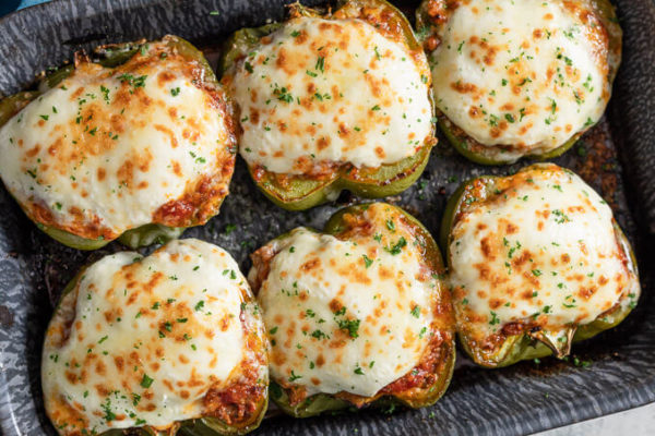 top-down-view of keto lasagna stuffed peppers in a pan