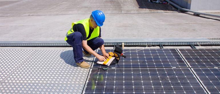 technician installing panels