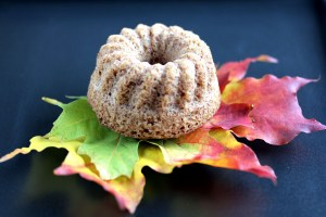Low-Carb Cinnamon Bundt Cake, Individual Bundt Cake Dusted with Powdered Erythritol, Served on Maple Leaves