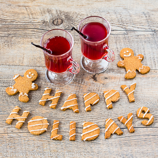 Image of happy holiday wishes with hot drink and cookie letters