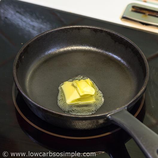 Fluffy 5-Ingredient Pumpkin Pancakes; Pat of Butter in the Pancake Pan | Low-Carb, So Simple