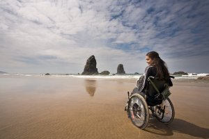 Lawrence Social Security Disability Attorney wheelchair on beach