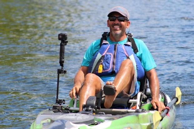 Merrimack River Watershed Council Board of Directors President Dan Graovac peddles a fishing kayak.