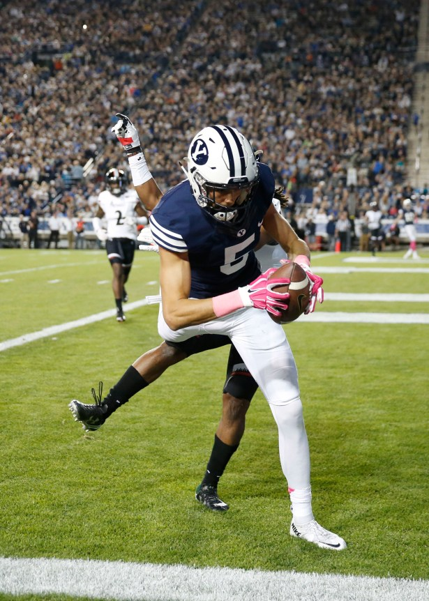 Oct 16, 2015; Provo, UT, USA; Brigham Young Cougars wide receiver Nick Kurtz (5) catches a third quarter touchdown pass against Cincinnati Bearcats cornerback Leviticus Payne (9) at Lavell Edwards Stadium. Mandatory Credit: Jeff Swinger-USA TODAY Sports