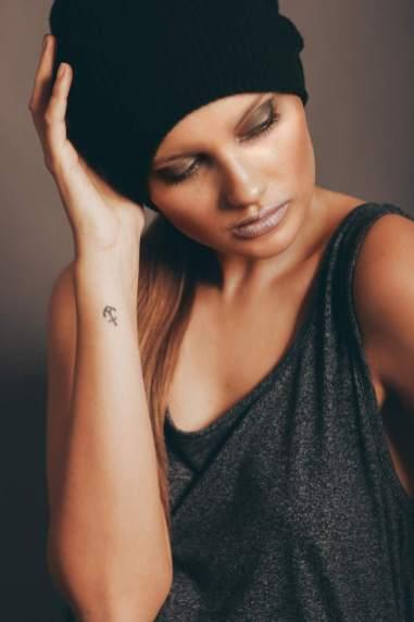 Symbol on Wrist Tattoo