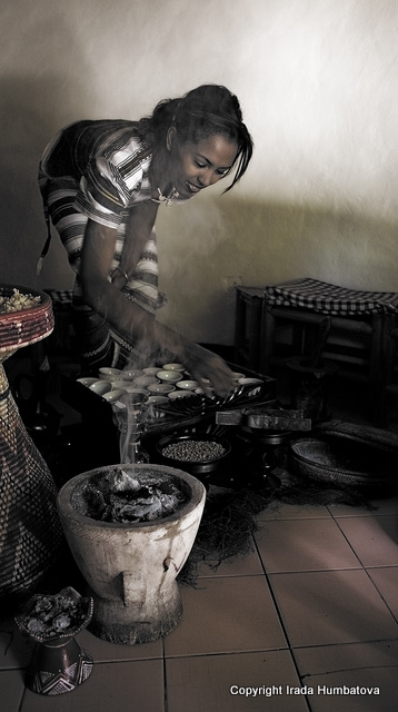 Ethiopian coffee ceremony - A beautiful woman serving coffee in true traditional Ethiopian fashion in Addis Ababa.