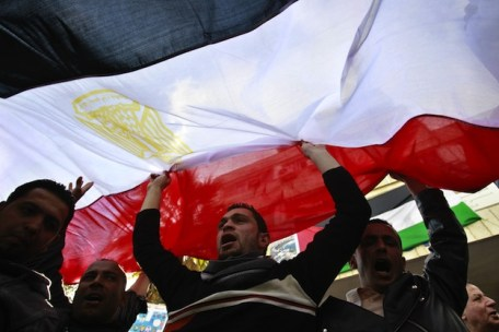 Jordanians and Egyptians living in Jordan hold up an Egyptian flag as they celebrate the resignation of Egypt's president Hosni Mubarak, in Amman, on February 12, 2011 | Credit: AFP PHOTO/STR/AFP/Getty Images