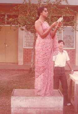 Teacher Rose Anne Easaw addressing the school assembly of Sekolah Menegah Inggeris/Kebangsaan, Yong Peng in 1977. Standing behind her is the writer.