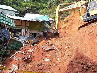 The orphanage's proximity to the hillside was likely to have a large impact on its collapse.