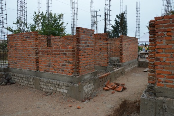 Offices. The grey brick is foundation. The floor will be almost a meter higher than where we stand now.