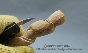 shaping a snake head in wood carving