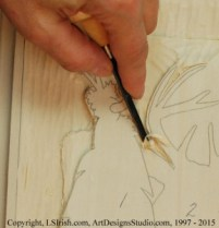 Cutting tight areas in a relief wood carving