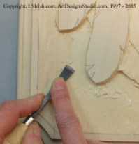 Smoothing the background of a relief wood carving