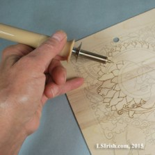 Hand position in wood burning
