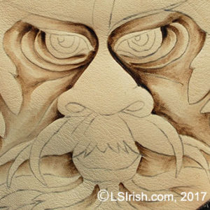 Pyrography burning the greenman face