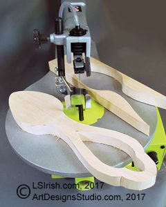 scroll saw cutting a wood carving spoon blank