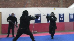 Two fighters duel it out in a sword fight at Wolfshead Martial Arts centre in Lincoln.