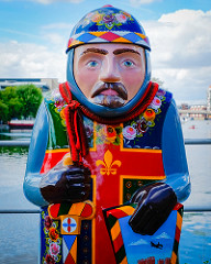 baron statue with a cross on chest . very colourful