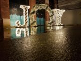 Hundreds of people lined up to have photographs taken by the 'JOY' sculpture. It was soon left alone after the switch-on.