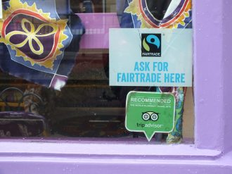 Fairtrade stickers identifying businesses that use Fairtrade importation