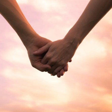 Image of two people holding hands amidst a beautiful sunrise. This image represents potential relationships, past relationships, and the grief around them.
