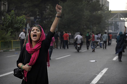 A supporter of defeated Iranian presidential candidate Mir Hossein Mousavi shouts slogans during riots in Tehran on June 13, 2009. Hardline incumbent Mahmoud Ahmadinejad was declared winner by a landslide in Iran's hotly-disputed presidential vote, triggering riots by opposition supporters and furious complaints of cheating from his defeated rivals. (OLIVIER LABAN-MATTEI/AFP/Getty Images)
