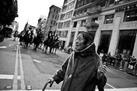 An old woman hurries to cross the street while the Parade is approaching. St. Patrick's Day Parade. San Francisco. 2007