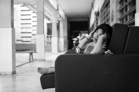 An handicapped girl sits in the courtyard of the GoVap Orphanage. Ho Chi Minh City. Vietnam. 2007