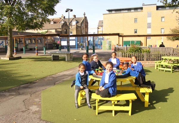 Children enjoying games in the sunshine in the Lucas Vale playground