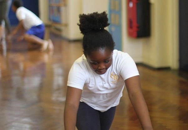 Girl stretching in PE