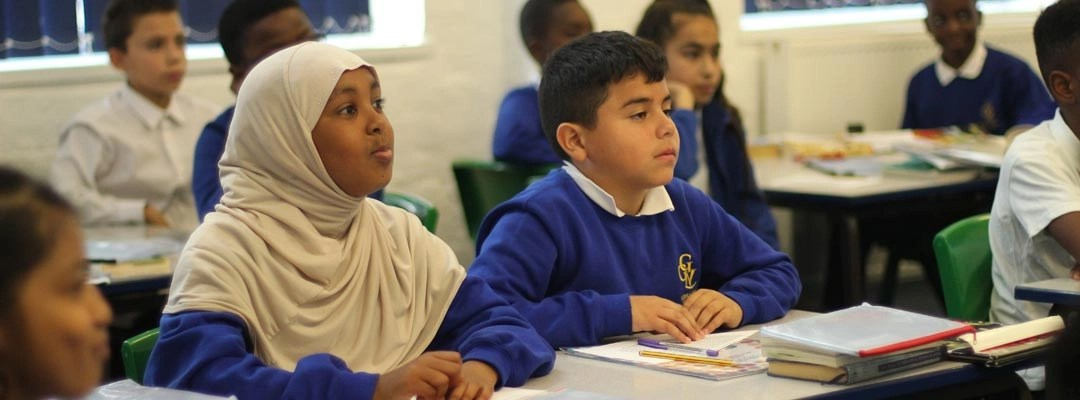 Children listening intensely during a lesson
