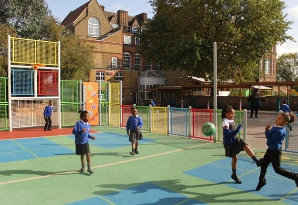 Mixed group of children playing football