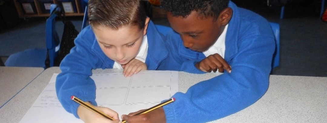 Children writing during a history lesson