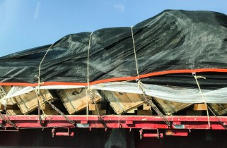 They're transported tilted over, protected with padding and wrapped with shade cloth