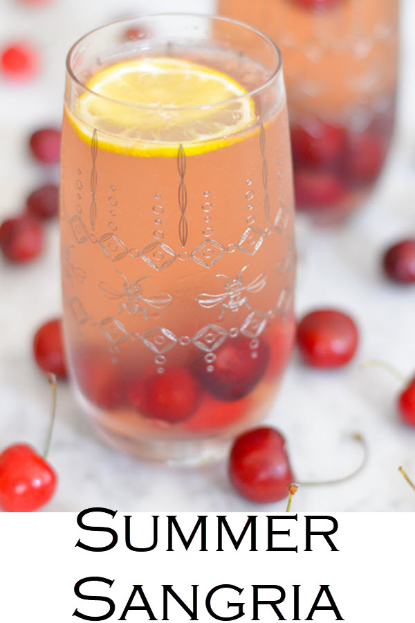 Cherry Sangria w. Chardonnay White Wine. A delicious summer sangria with fresh cherries, white wine, and elderflower. An easy summer alcoholic drink everyone will love!