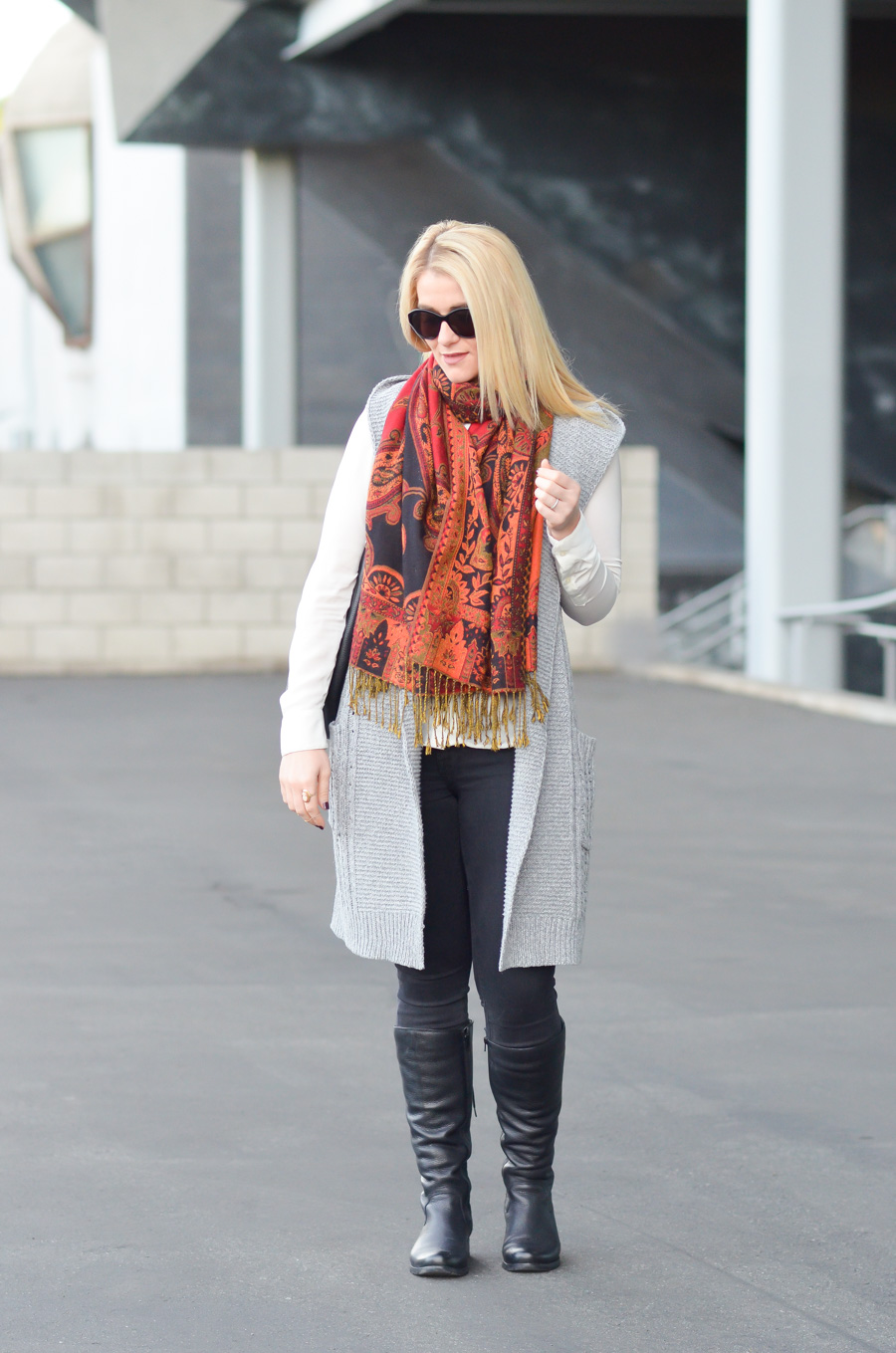 Long Sweater Vest Outfit. Silver Jeans + Black Skinny Denim tucked into Boots.