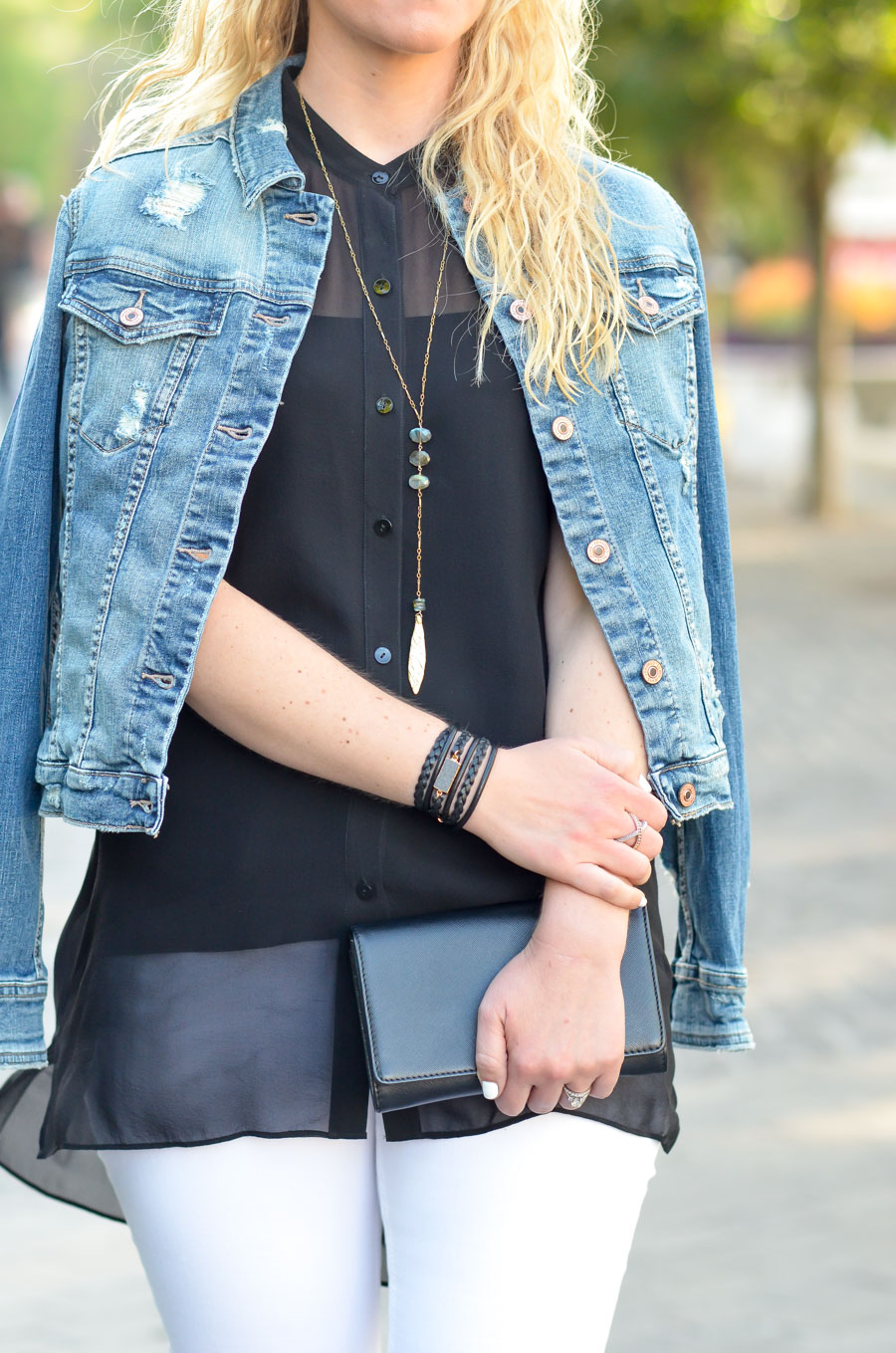 Black Top with White Jeans and Denim Jacket Outfit