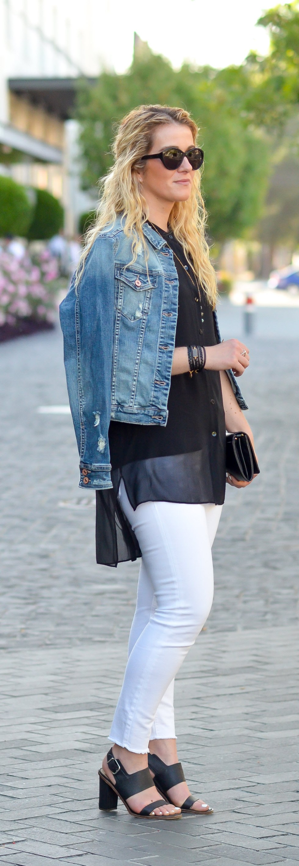 Black Top with White Jeans Outfit. A perfect date night outfit. White jeans with a denim jacket is the perfect way to look chic and casual all at the same time!