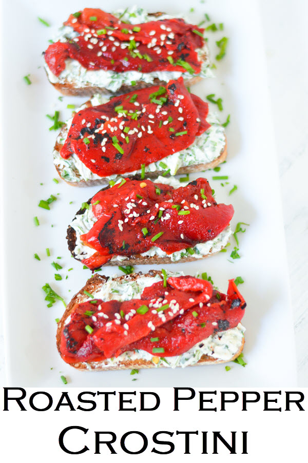 Goat Cheese Crostinis topped with fire roasted bell peppers. This delicious appetizer recipe is perfect year round. Whether you use store bought or homemade roasted bell peppers, this vibrant appetizer is perfect in spring, summer, winter, and fall. Goat cheese and pepper toasts are easy and delicious.