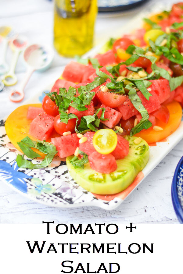Tomato + Watermelon Salad. A perfect summer salad with heirloom tomatoes and watermelon. A delicious salad to serve guests on a warm evening. Great salad for potlucks and bbqs.