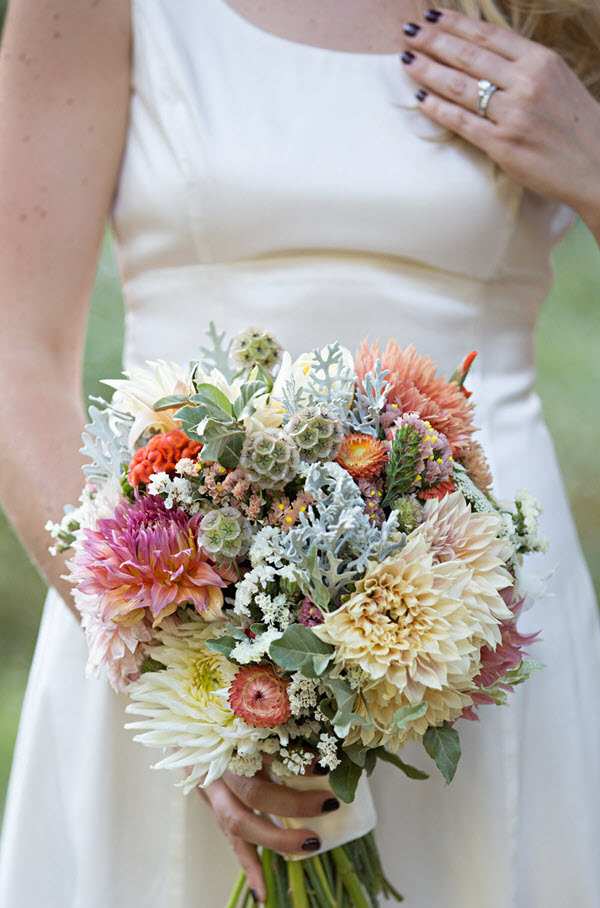Wedding Bouquet Flowers in white, peach, and dark green. Wondering about Designing Your Own Wedding Dress? This is my short story of my homemade wedding dress, including why I didn't buy my wedding dress and how we designed it.