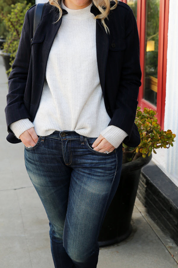 Tips on Layering Clothes for Winter. This White Turtleneck Sweater Outfit with Jeans pairs the winter fashion trends of layers and white turtleneck sweaters. A fashion blogger outfit for women over 30.
