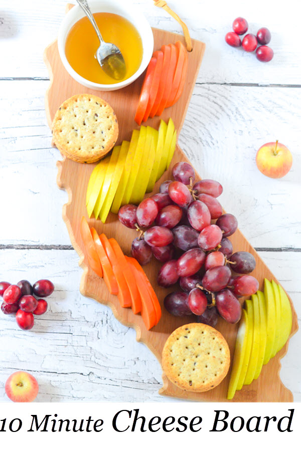 10 Minute Fast Cheese Board. Fresh Fruit Appetizer Board for 4 People. An easy starter for entertaining guests. This board is great to put out for guests when they arrive before food is ready! #entertaining #appetizer #vegan #dinnerparty #appetizer #foodblog
