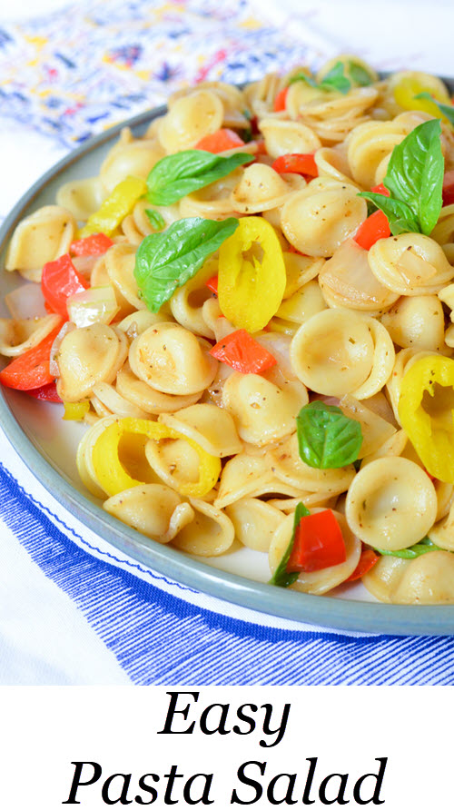 Easy Italian Pasta Salad Recipe. This veggie salad is a perfect summer potluck recipe. It's vegan and delicious. Enjoy pasta with fresh vegetables and a dash of vinegar. The banana peppers really bring it all together! #pasta #pastasalad #bbq #potluck #summer #salad #foodblog #foodbloger #lmrecipes