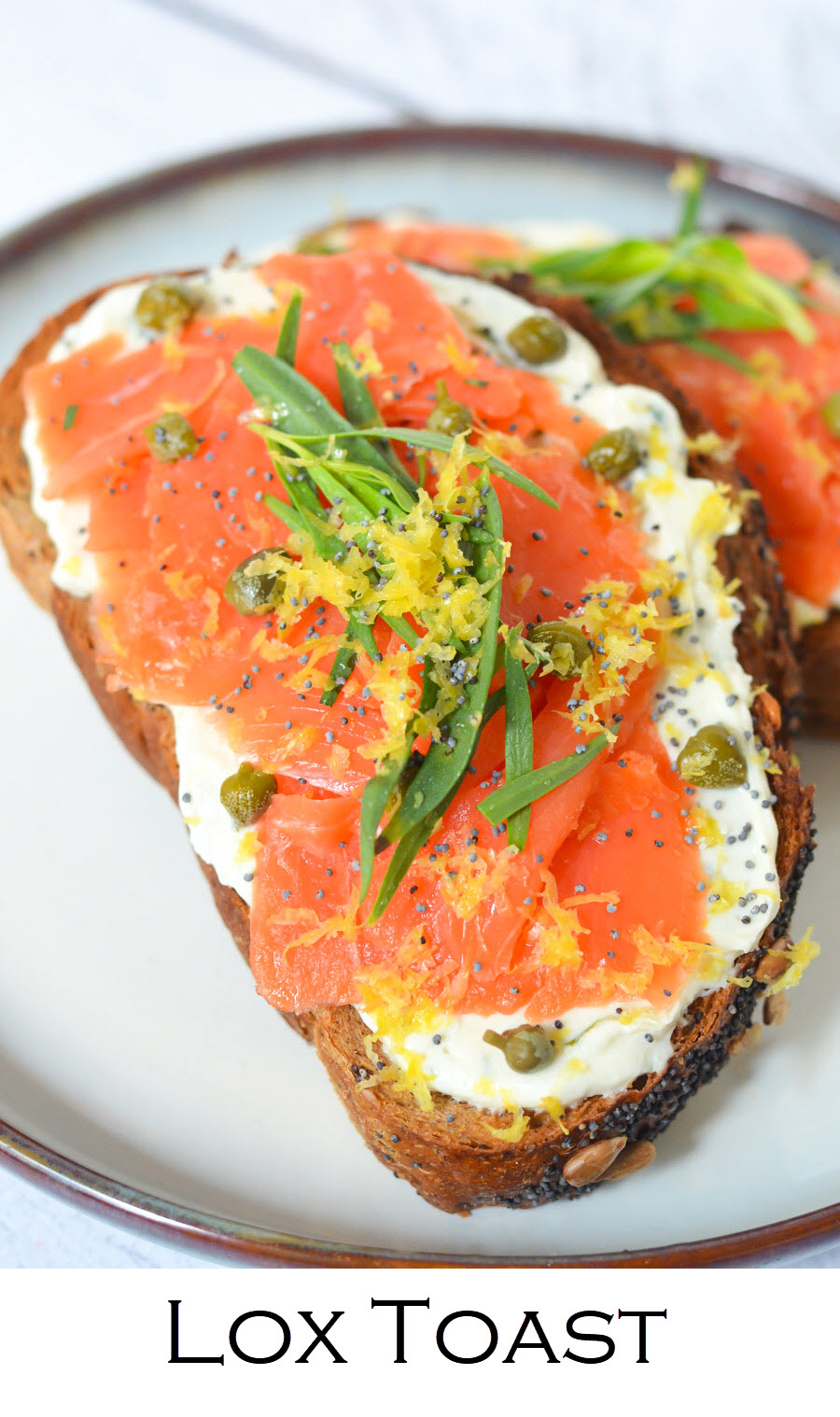 Lox Toast. Whip up this easy smoked salmon tartine for breakfast, lunch, or dinner. Good lox layered over goat cheese on delicious bread! #breakfast #brunch #salmon #tartine #toasts #recipe #foodblog #homemade #foodblogger #lmrecipes