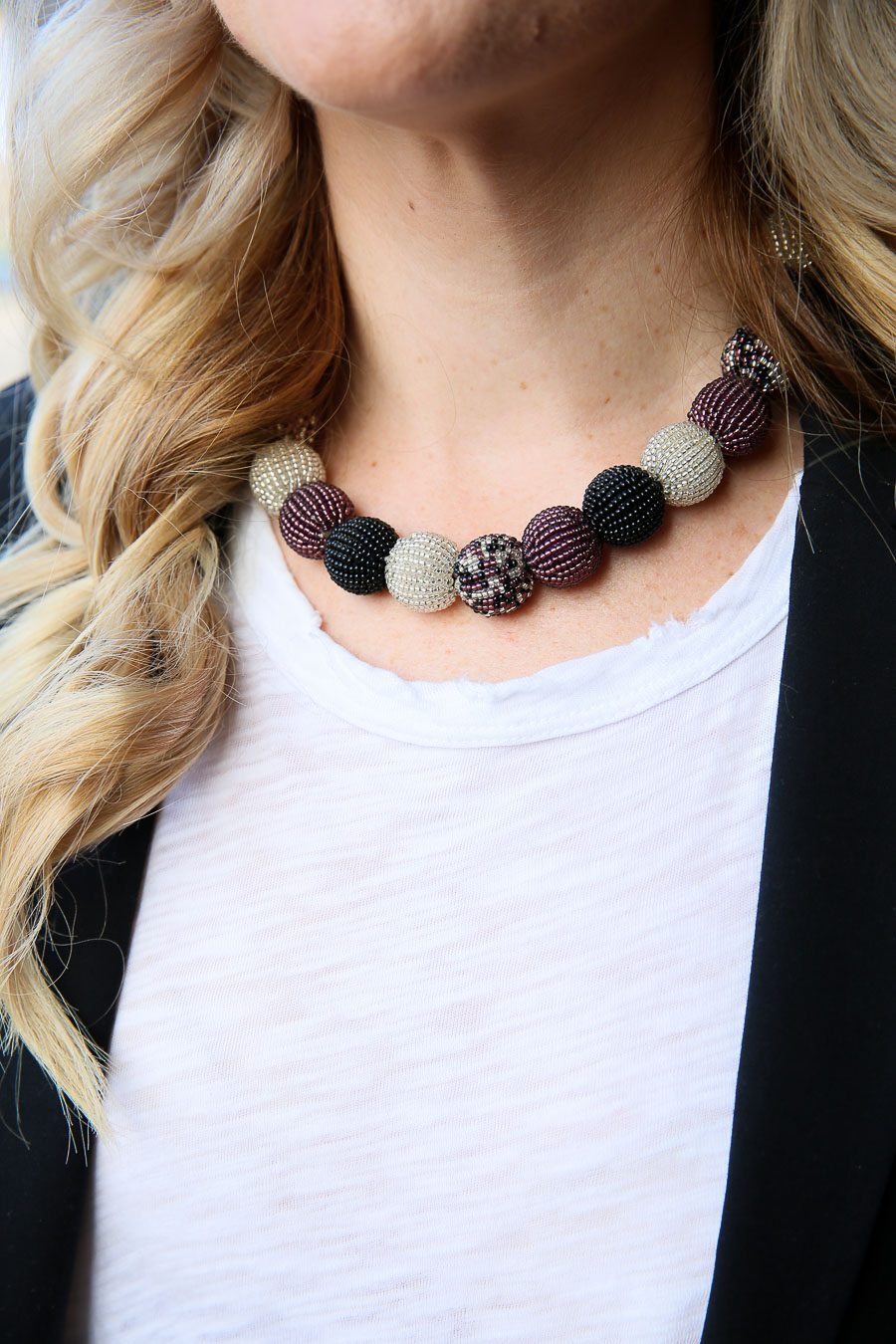 Ball Necklace. This purple, black, and multicolor necklace matches any outfit. How to Dress Up Boyfriend Jeans - Ripped Boyfriend Jeans. #accessories #jewelry #necklace #ootd