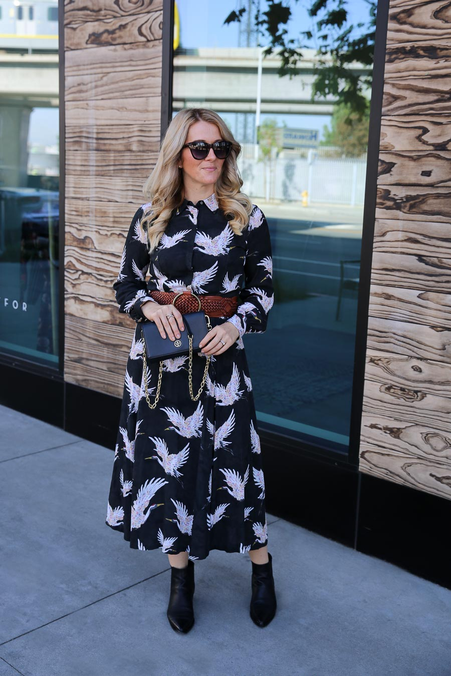 How to Wear Booties with a Dress. A black print midi dress with booties.