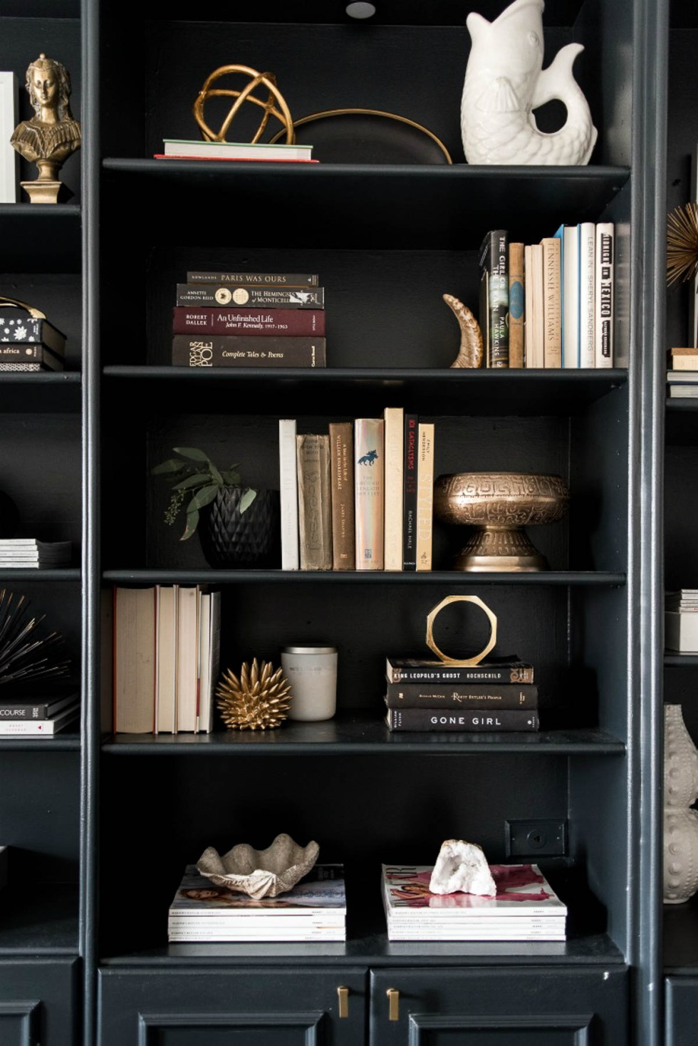 How to Style a Black Bookshelf - gold accent decor